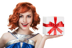 Happy woman with a gift Royalty Free Stock Images