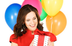 Happy woman with gift box Royalty Free Stock Images