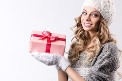 Happy woman with gift box in hands. Stock Photos