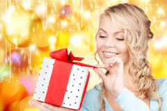 Happy woman with gift box Stock Photography