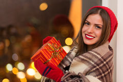 Happy woman with gift box Royalty Free Stock Image