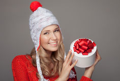 Happy woman with a gift. Holidays. Royalty Free Stock Photo