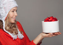 Happy woman with a gift. Holidays. Stock Images