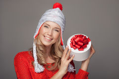 Happy woman with a gift. Holidays. Royalty Free Stock Image