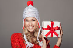 Happy woman with a gift. Holidays. Stock Photo