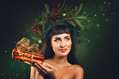Happy woman with gift pack in hand Royalty Free Stock Image