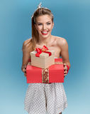 Happy woman with a gift Stock Images