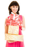 Happy woman with gifts in red dress Stock Photography