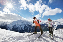 Happy woman and girl on mountains ski resort royalty free stock photography