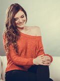Happy woman girl sitting on couch at home. Royalty Free Stock Photo