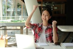 Happy woman girl teenager raising hands with gladness happiness. Happy asian woman girl teenager raising hands with gladness happiness stock image