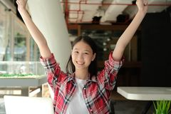 Happy woman girl teenager raising hands with gladness happiness. Happy asian woman girl teenager raising hands with gladness happiness royalty free stock photo