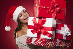 Happy woman with gitfs Stock Images