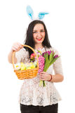 Happy woman gives Easter basket Stock Photography