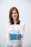 Happy woman giving gift on camera Royalty Free Stock Photos