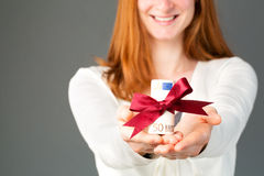Happy woman giving money as a gift Stock Image