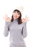 Happy woman giving ok hand sign, winter dress Stock Photos
