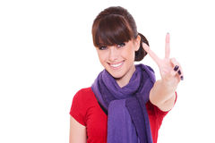 Happy woman giving peace sign Royalty Free Stock Images