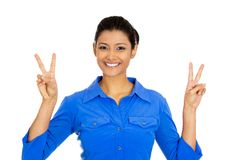 Happy woman giving peace victory or two sign gestur. Closeup portrait of young happy smiling confident excited woman giving peace victory or two sign gesture Royalty Free Stock Images