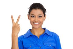 Happy woman giving peace victory or two sign gesture. Closeup portrait of young happy confident excited pretty woman giving peace victory or two sign gesture Stock Photo