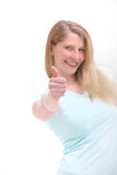 Happy woman giving thumbs up Royalty Free Stock Photos
