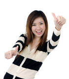Happy woman giving thumbs up sign Royalty Free Stock Image