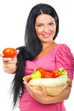 Happy woman giving tomato stock image