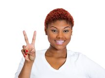 Happy woman giving victory sign Royalty Free Stock Photo