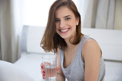 Happy woman with glass of water Royalty Free Stock Image