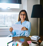 Happy woman in glasses holding envelope Royalty Free Stock Images