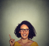 Happy woman in glasses pointing up with her finger Royalty Free Stock Image