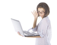 Happy woman in glasses using laptop Stock Photography