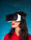 Happy woman with glasses of virtual reality. Stock Photo