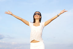 A happy woman in glasses and a white dress Stock Images