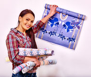 Happy woman glues wallpaper . Stock Photos