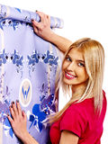 Happy woman glues wallpaper . Royalty Free Stock Photo