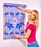 Happy woman glues wallpaper Royalty Free Stock Image