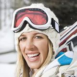 Happy woman going skiing. Stock Images