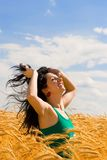 Happy woman in golden wheat Stock Photos