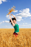 Happy woman in golden wheat Royalty Free Stock Images