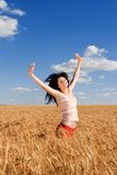 Happy woman in golden wheat Stock Image