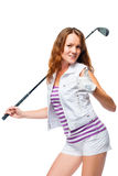 Happy woman with a golf club holds a thumb up against a white Stock Photos