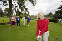 Happy Woman Golfing royalty free stock images