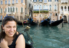 Happy woman with gondola in Venice Royalty Free Stock Photography
