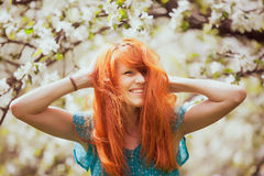 Happy Woman with Gorgeous Red Hair royalty free stock image