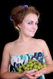 Happy woman with grape Stock Photos