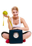 Happy woman with grapefruit and weighing scale Royalty Free Stock Photos
