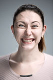 The happy woman on gray background Stock Photo