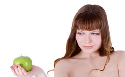 Happy woman with green apple Royalty Free Stock Photography