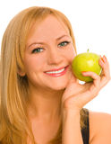 Happy woman with a green apple Stock Image
